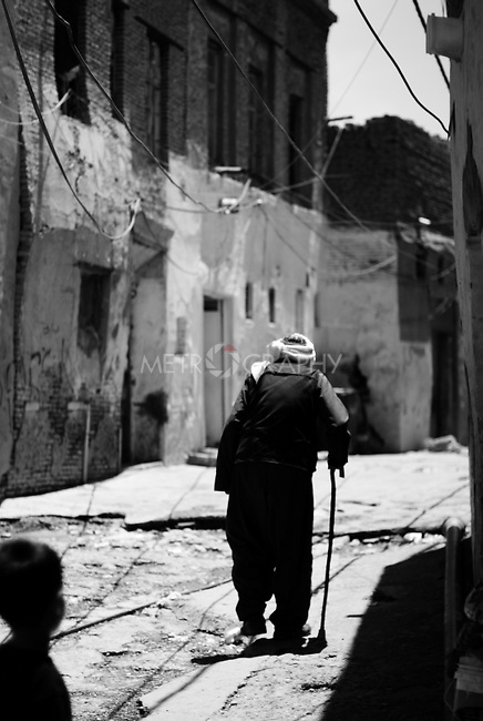 ERBIL, IRAQ: Old man heading home after praying. .Exploring the old markets of Erbil during a hot afterrnoon.