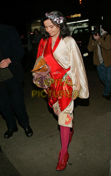 BJORK.Seen outside Museum of Modern Art (MOMA), New York, NY, UK..March 28th, 2006.Photo: Jackson Lee/Admedia/Capital Pictures.Ref: JL/ADM.full length red white pink kimono wrap dress.www.capitalpictures.com.sales@capitalpictures.com.© Capital Pictures.