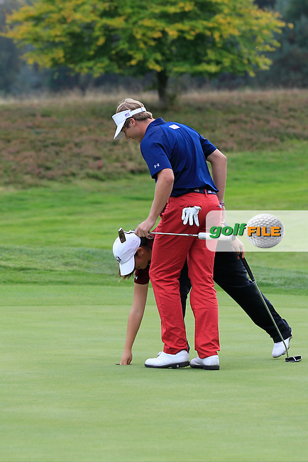 Andrea Lee &amp; Marcus Kinhult (USA) on the 18th hole in the Mixed Fourballs during the 2014 JUNIOR RYDER CUP at the Blairgowrie Golf Club, Perthshire, Scotland. <br /> Picture:  Thos Caffrey / www.golffile.ie
