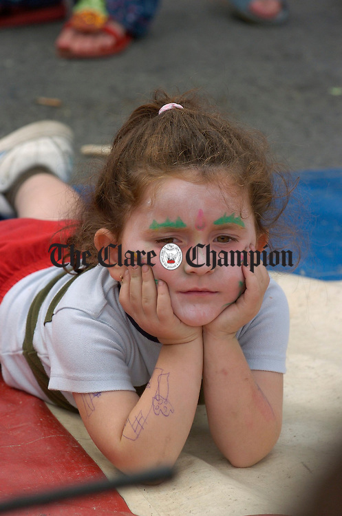 Young Eileen Delaney watching all the action during the street carnival in Ennis market on Sunday. Photograph by John Kelly.