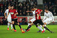 Wayne Routledge of Swansea (C) struggles to get past Jonny Evans of West Bromwich Albion (2nd R) during the Barclays Premier League match between Swansea City and West Bromwich Albion played at the Liberty Stadium, Swansea on December 26 2015