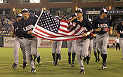 DJ Baxendale (48) and Dominic Ficociello (32) lead Team USA in a victory lap following Game 3 of the annual Collegiate Friendship Series between Team USA and Japan on Tuesday, July 5, 2011. Photo by Al Drago.