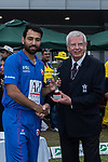 Babar Hayatof Kowloon Cantons (L) is presented with the trophy by Rodney Miles, president of Hong Kong Cricket Association, (R) after the final match of the Hong Kong T20 Blitz between Kowloon Cantons and City Kaitak at Tin Kwong Road Recreation Ground, Hong Kong, China. Photo by Chris Wong / Power Sport Images