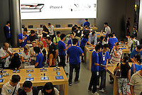 Customers in the new Apple Computer shop in IFC mall, Hong Kong. Apple's first retail store opens in the heart of Central,Hong Kong on September 22, 2011. With more than 300 passionate employees, customers can get help and learn everything they need to know about Apple products................