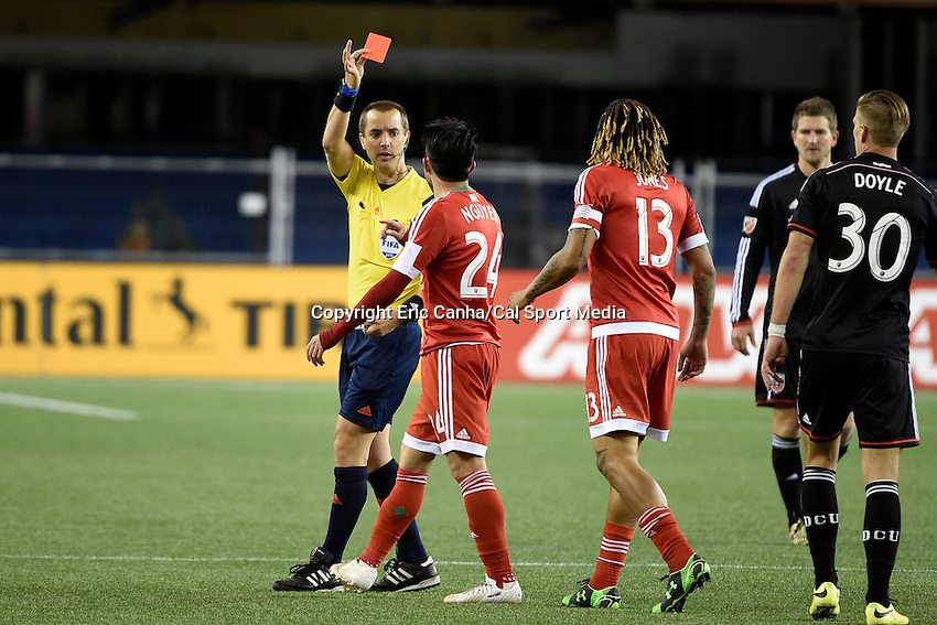 May 23, 2015 - Foxborough, Massachusetts, U.S. - New England Revolution midfielder Lee Nguyen (24) receives a red card during the MLS game between DC United and the New England Revolution held at Gillette Stadium in Foxborough Massachusetts. The New England Revolution and D.C. United ended the game tied 1-1.  Eric Canha/CSM