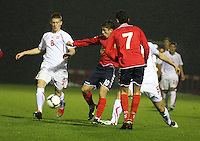 Vardan Bakalyan (left) being pulled back by Ferid Matri as Thibault Corbaz (8) assists in the Armenia v Switzerland UEFA European Under-19 Championship Qualifying Round match at New Douglas Park, Hamilton on 11.10.12.