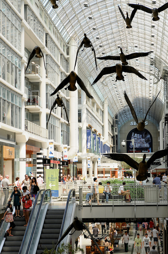 Michael Snow's Geese fly overhead of people shopping at Toronto's Eaton Centre