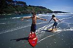 Young Boys skim Boarding at Big River beach, Mendocino California