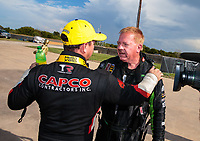 Oct 7, 2018; Ennis, TX, USA; NHRA top fuel driver Steve Torrence (left) is congratulated by Terry McMillen after winning the Fall Nationals at the Texas Motorplex. Mandatory Credit: Mark J. Rebilas-USA TODAY Sports