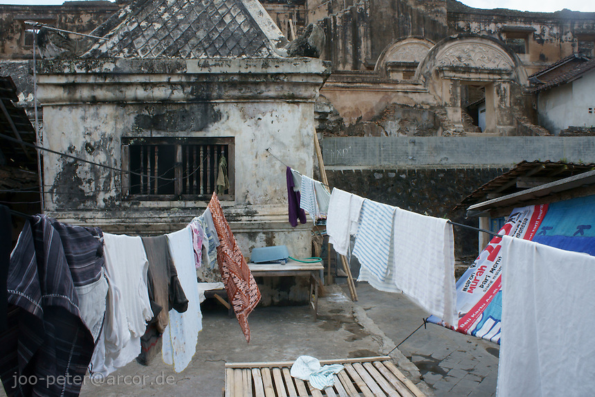 clothes hang out for drying at a building conected to the water castle, Yogyakarta, island Java, archipelago of Indonesia,  September 2011