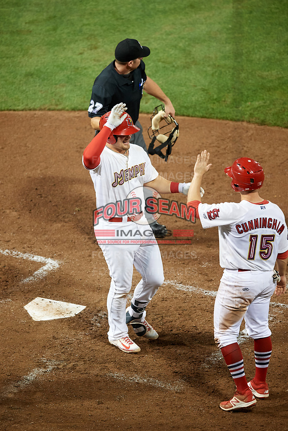 Memphis Redbirds first baseman Luke Voit (35) is congratulated by Todd Cunningham (15) as he crosses home plate after hitting a home run in the bottom of the sixth inning during a game against the Round Rock Express on April 28, 2017 at AutoZone Park in Memphis, Tennessee.  Memphis defeated Round Rock 9-1.  (Mike Janes/Four Seam Images)