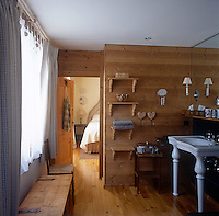 An ensuite bathroom in a traditional style wood panelled Swiss chalet.