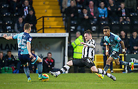 Matt Tootle of Notts Co goes in for a tackle on Dominic Gape of Wycombe Wanderers during the Sky Bet League 2 match between Notts County and Wycombe Wanderers at Meadow Lane, Nottingham, England on 10 December 2016. Photo by Andy Rowland.