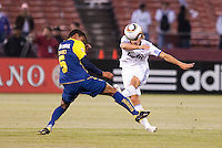 Sergio Canales (left) kicks the ball against Adolfo Rosinei (left). Real Madrid defeated Club America 3-2 at Candlestick Park in San Francisco, California on August 4th, 2010.