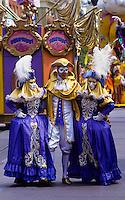 Martigra masked carnival dancers in Disney World, Florida, USA