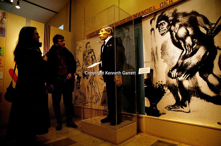 Display of a Neandertal dressed in a modern suit, Neandertal Museum, Erkrath, Germany.