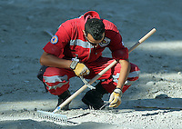 FAO JANET TOMLINSON, DAILY MAIL PICTURE DESK<br /> Pictured: A Red Cross volunteer searches a field in Kos, Greece. Monday 03 October 2016<br /> Re: Police teams led by South Yorkshire Police, searching for missing toddler Ben Needham on the Greek island of Kos have moved to a new area in the field they are searching.<br /> Ben, from Sheffield, was 21 months old when he disappeared on 24 July 1991 during a family holiday.<br /> Digging has begun at a new site after a fresh line of inquiry suggested he could have been crushed by a digger.