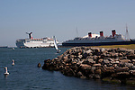 Carnival cruise ship, Queen Mary and a sailboat in the Long Beach Harbor.