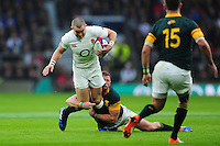 Mike Brown of England takes on the South Africa defence. Old Mutual Wealth Series International match between England and South Africa on November 12, 2016 at Twickenham Stadium in London, England. Photo by: Patrick Khachfe / Onside Images