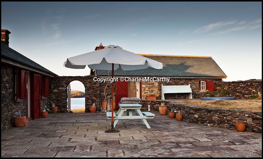 BNPS.co.uk (01202 558833)<br /> Pic: CharlesMcCarthy/BNPS<br /> <br /> The courtyard.<br /> <br /> This beautiful Irish island could be the ultimate get away from stressed out city living and comes complete with an old airstrip. <br /> <br /> Whoever stumps up £1.5million for the peaceful 33 acre plot will live in four traditional stone cottages - which have all been recently renovated.  <br /> <br /> And despite sitting 1.5 miles off the South East coast of Ireland its not completely cut off from civilization.