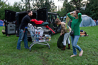 Participants unpack their belongings from a car into a shopping cart on Sziget festival held in Budapest, Hungary on August 07, 2011. ATTILA VOLGYI
