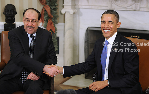 United States President Barack Obama, right, and Prime Minister Nouri al-Maliki of Iraq, left, shake hands during a photo-op prior to a meeting in the Oval Office of the White House, Monday, December 12, 2011 in Washington, DC..Credit: Olivier Douliery / Pool via CNP