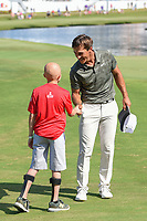 Thorbjorn Olesen (DEN) shakes hands with a young St. Jude patient near the green on 18 following round 4 of the WGC FedEx St. Jude Invitational, TPC Southwind, Memphis, Tennessee, USA. 7/28/2019.<br /> Picture Ken Murray / Golffile.ie<br /> <br /> All photo usage must carry mandatory copyright credit (© Golffile | Ken Murray)
