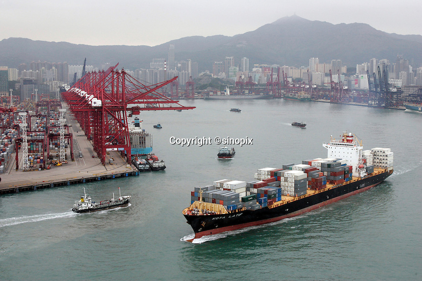 A view of a half-full container ship at the port of Hong Kong, China. It is not uncommon to see ships with their hull high in the water carrying less cargo than before the global economic crisis hit global demand for goods. Asian shipping shares slumped Tuesday, reflecting a decrease in global demand for commodities and an industry suffering from excess capacity due to the global downturn in trade..
