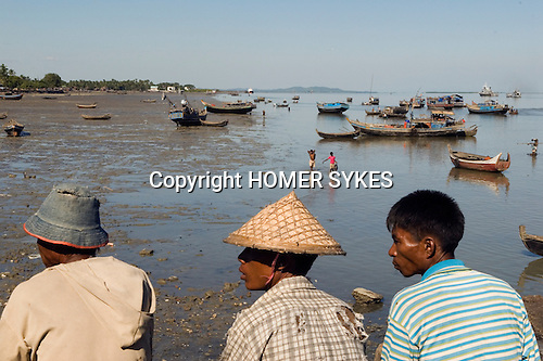 Sittwe Northern Rakhaing province Myanmar (Burma) 2008. Kaladan River. Small fish drying in the sun. Fishermen bringing their catch in.