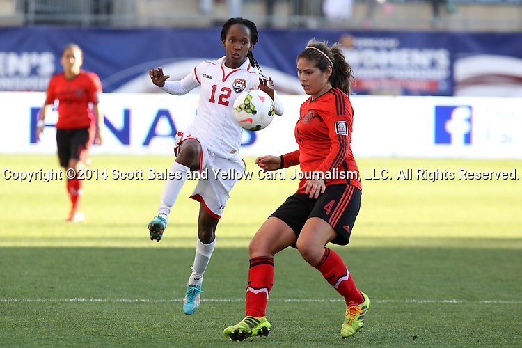 26 October 2014: Ahkeela Mollon (TRI) (12) and Alina Garciamendez (MEX) (4). The Trinidad & Tobago Women's National Team played the Mexico Women's National Team at PPL Park in Chester, Pennsylvania in the 2014 CONCACAF Women's Championship Third Place game. Mexico won the game 4-2 after extra time. With the win, Mexico qualified for next year's Women's World Cup in Canada and Trinidad & Tobago face playoff for spot against Ecuador.