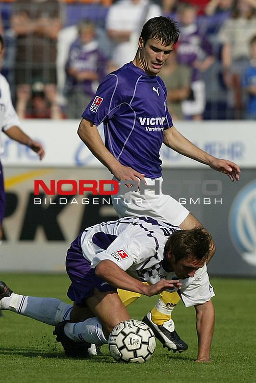 2. BL 2003/2004 - 6. Spieltag<br /> VFL Osnabrueck vs. Erzgebirge Aue 0:1<br /> Marcel Schied (vorne) von Osnabrueck im Zweikampf mit<br /> Joerg Emmerich (hinten) von Aue.<br /> Foto &copy; nordphoto - Ruediger Lampe<br /> <br />  *** Local Caption *** Foto ist honorarpflichtig! zzgl. gesetzl. MwSt.<br />  Belegexemplar erforderlich<br /> Adresse: nordphoto<br /> Georg-Reinke-Strasse 1<br /> 49377 Vechta