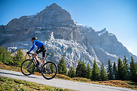 Road biking on the Swiss Alps classic Grosse Scheidegg, a pass connecting Grindelwald with Meiringen, in the Berner Oberland, Switzerland. Above rises the Wetterhorn.