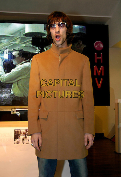 RICHARD ASHCROFT.Former Verve frontman meets fans and signs copies of his latest solo album, Keys To The World, HMV Oxford Street, London, UK..January 23rd, 2006.Ref: HT.half length beige brown coat sunglasses shades tinted glasses mouth open.www.capitalpictures.com.sales@capitalpictures.com.© Capital Pictures.
