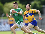 Danny Neville of Limerick in action against John Hayes of Clare during their Munster championship quarter-final game in Cusack park. Photograph by John Kelly.