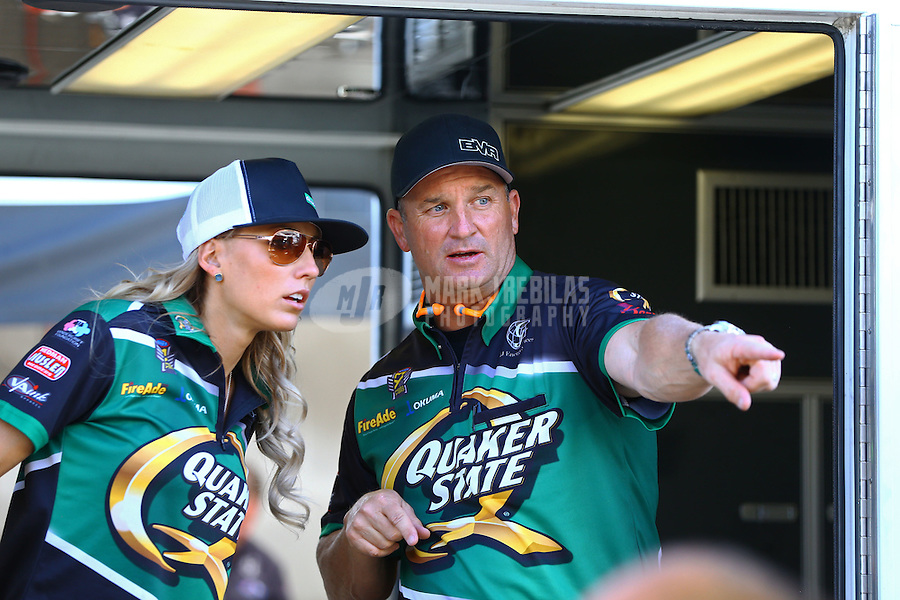 Feb 28, 2016; Chandler, AZ, USA; NHRA top fuel team owner Bob Vandergriff (right) with driver Leah Pritchett during the Carquest Nationals at Wild Horse Pass Motorsports Park. Mandatory Credit: Mark J. Rebilas-