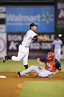 Cleuluis Rondon (16) of the Kannapolis Intimidators makes a throw to first base as Jeff Gardner (36) of the Hagerstown Suns slides into second base at Kannapolis Intimidators Stadium on May 6, 2016 in Kannapolis, North Carolina.  The Intimidators defeated the Suns 5-3.  (Brian Westerholt/Four Seam Images)