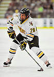 30 October 2010: University of Vermont Catamount forward Brett Leonard, a Senior from South Burlington, VT, in action against the University of Maine Black Bears at Gutterson Fieldhouse in Burlington, Vermont. The Black Bears defeated the Catamounts 3-2 in sudden death overtime. Mandatory Credit: Ed Wolfstein Photo