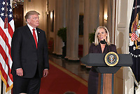 Principal Deputy White House Chief of Staff Kirstjen Nielsen, right, makes remarks after United States President Donald J. Trump, left, announced he will name her as Secretary of Homeland Security in the East Room of the White House in Washington, DC on Thursday, October 12, 2017.  If confirmed, Nielsen will replace Acting US Secretary of Homeland Security Elaine C. Duke, who has been in that position since General John F. Kelly, USMC (Retired) resigned to become White House Chief of Staff.<br /> Credit: Ron Sachs / CNP /MediaPunch