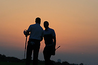 Richard McEvoy (ENG) shakes hands with his playing partner Jeunghun Wang (KOR) during the first round of the NBO Open played at Al Mouj Golf, Muscat, Sultanate of Oman. <br /> 15/02/2018.<br /> Picture: Golffile | Phil Inglis<br /> <br /> <br /> All photo usage must carry mandatory copyright credit (&copy; Golffile | Phil Inglis)