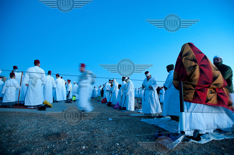 Samaritan men say Passover prayers on the summit of Mount Gerizim, above the town of Nablus, the religion's most holy site.