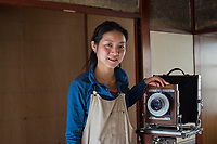 Japan, Ishikawa, Yamanaka. Photographer and paper artist. Mika makes her paper by hand from the Gampi bush, and creates photograms on them from her large format camera. The idea is to photograph nature and print it on nature. Model released