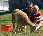 BETHLEHEM, CT - 01 SEPTEMBER 2008 -090108JT11--<br /> Jason Behuniak, of Watertown, holds his son Aiden, 1, as they and Behuniak's wife Cathy (not picture) watch a goat at the animal yard at March Farm on Labor Day, Sept. 1, 2008.<br /> Josalee Thrift Republican-American