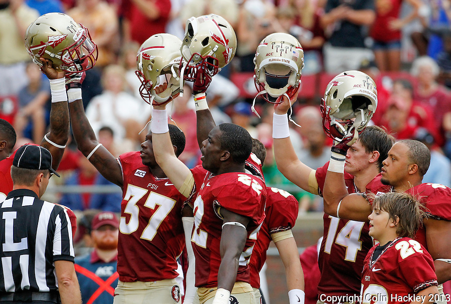 TALLAHASSEE, FLA 9/21/13-FSU-BCC092113CH-Florida State players cheer after Osceola plants the spear at midfield before the  Bethune-Cookman game Saturday at Doak Campbell Stadium in Tallahassee. <br /> COLIN HACKLEY PHOTO