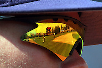The field is reflected inside the glasses of Clemson infielder Mike Dunster (10) during the game against Virginia Sunday at Davenport Field in Charlottesville, VA. Photo/Daily Progress/Andrew Shurtleff