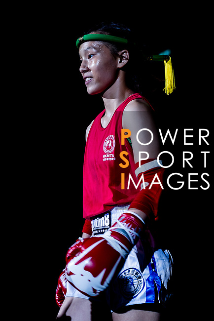 Kwok Hoi Ling (Red) of Hong Kong enters to the ring prior the female muay 48KG division weight bout against Sereenen Mungungerel (Not in picture) of Mongolia in during the East Asian Muaythai Championships 2017 at the Queen Elizabeth Stadium on 11 August 2017, in Hong Kong, China. Photo by Yu Chun Christopher Wong / Power Sport Images