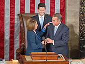 Outgoing Speaker of the United States House of Representatives John Boehner (Republican of Ohio), right, and former Speaker of the United States House of Representatives and current US House Minority Leader Nancy Pelosi (Democrat of California), left, hug as incoming Speaker of the US House of Representatives Paul Ryan (Republican of Wisconsin), center, looks on as Ryan assumes his duties of the office in the US House Chamber in the US Capitol in Washington, DC on Thursday, October 29, 2015.<br /> Credit: Ron Sachs / CNP