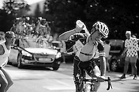 Michal Kwiatkowski (POL/Omega Pharma-Quickstep) trying to keep cool with bottles by fans up the final climb to Chamrousse (1730m/18.2km/7.3%)<br /> <br /> 2014 Tour de France<br /> stage 13: Saint-Etiènne - Chamrousse (197km)