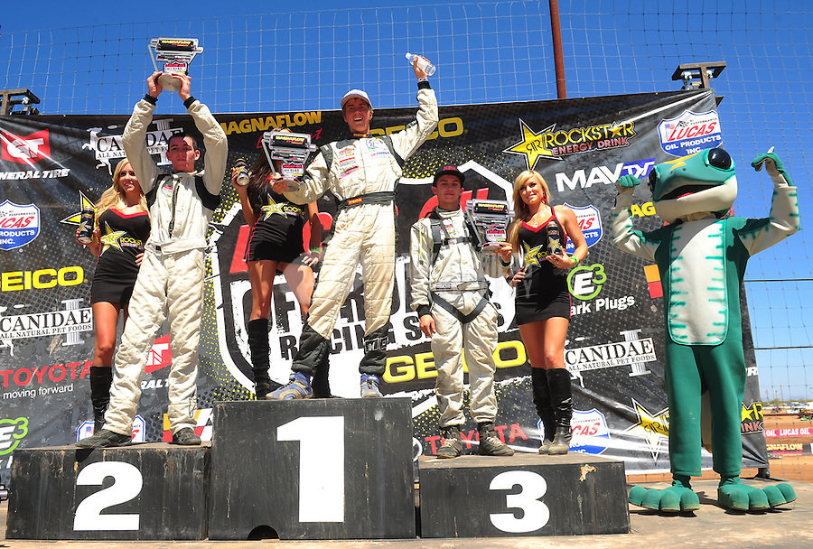 Apr 16, 2011; Surprise, AZ USA; LOORRS driver Dave Mason Jr (center) on the podium with Quentin Tucker (left) and Kevin McCullough following round 3 at Speedworld Off Road Park. Mandatory Credit: Mark J. Rebilas-.