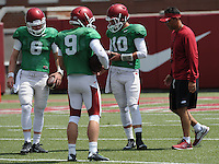 NWA Democrat-Gazette/ANDY SHUPE<br /> Arkansas offensive coordinator and quarterbacks coach Dan Enos (right) speaks to quarterbacks Austin Allen (8), Rafe Peavey (9) and Brandon Allen (10) Thursday, Aug. 13, 2015, during practice at the university practice field in Fayetteville.