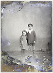 severely eroding glass plate with brother and sister